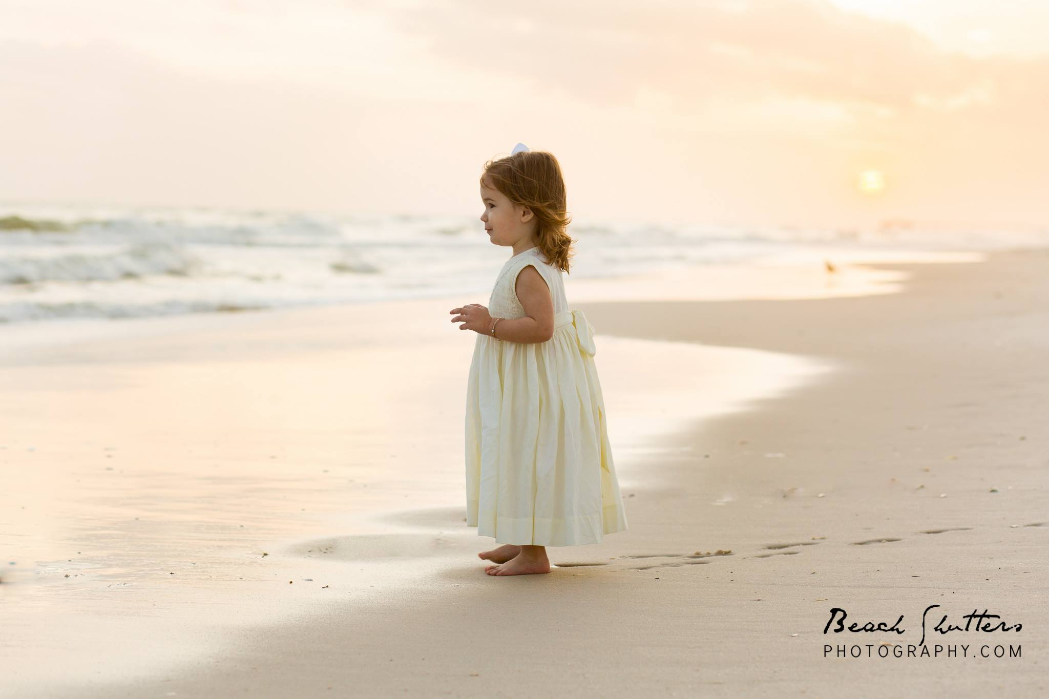 a family sunset session for photos at the Beach in Gulf Shores Alabama