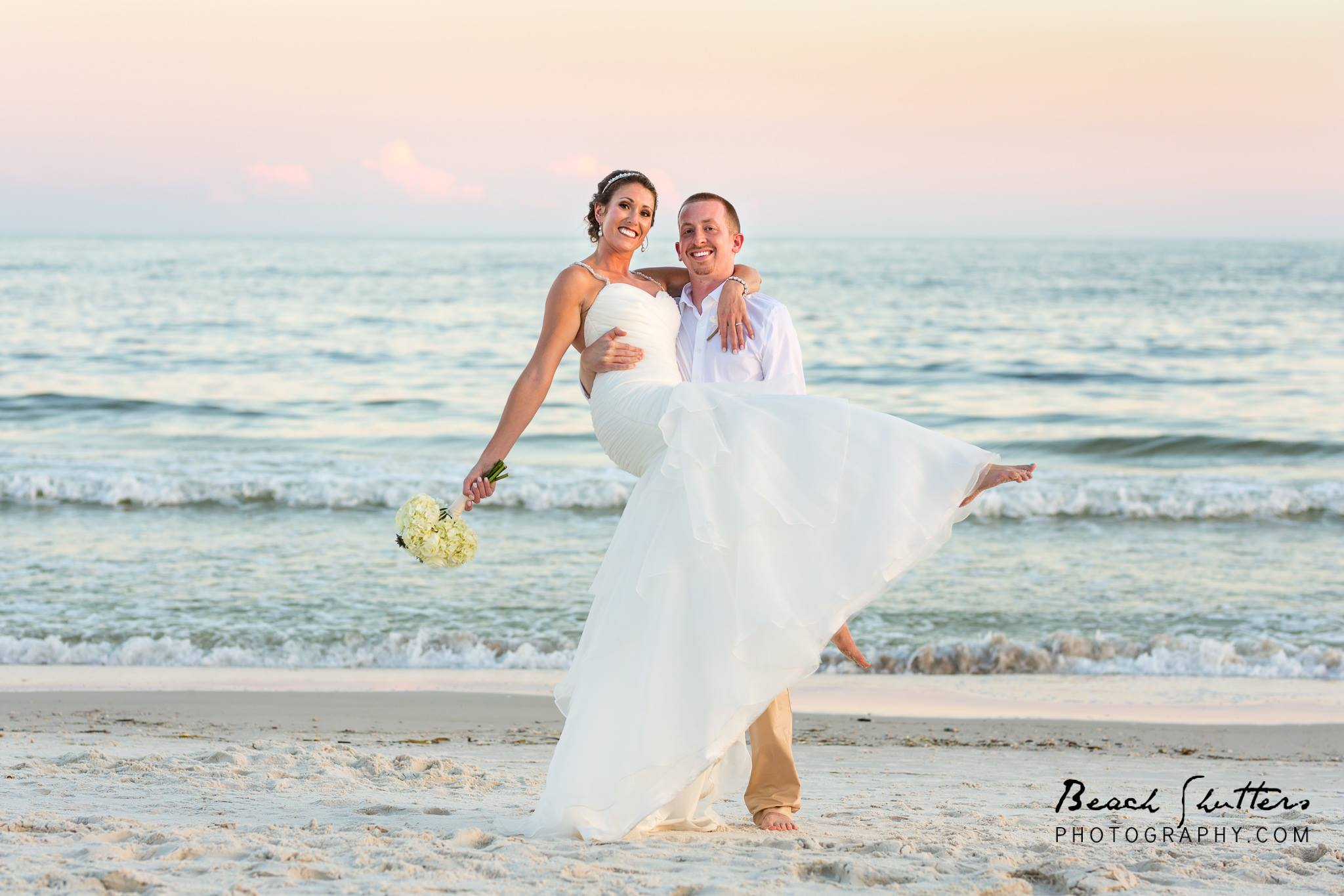 Wedding Photo of a bride and groom at the waters edege