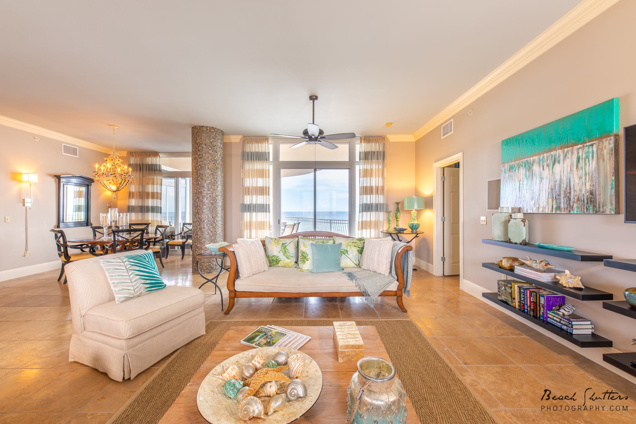 A view of the Coffee Table with the beach in the Background staged for real estate photography