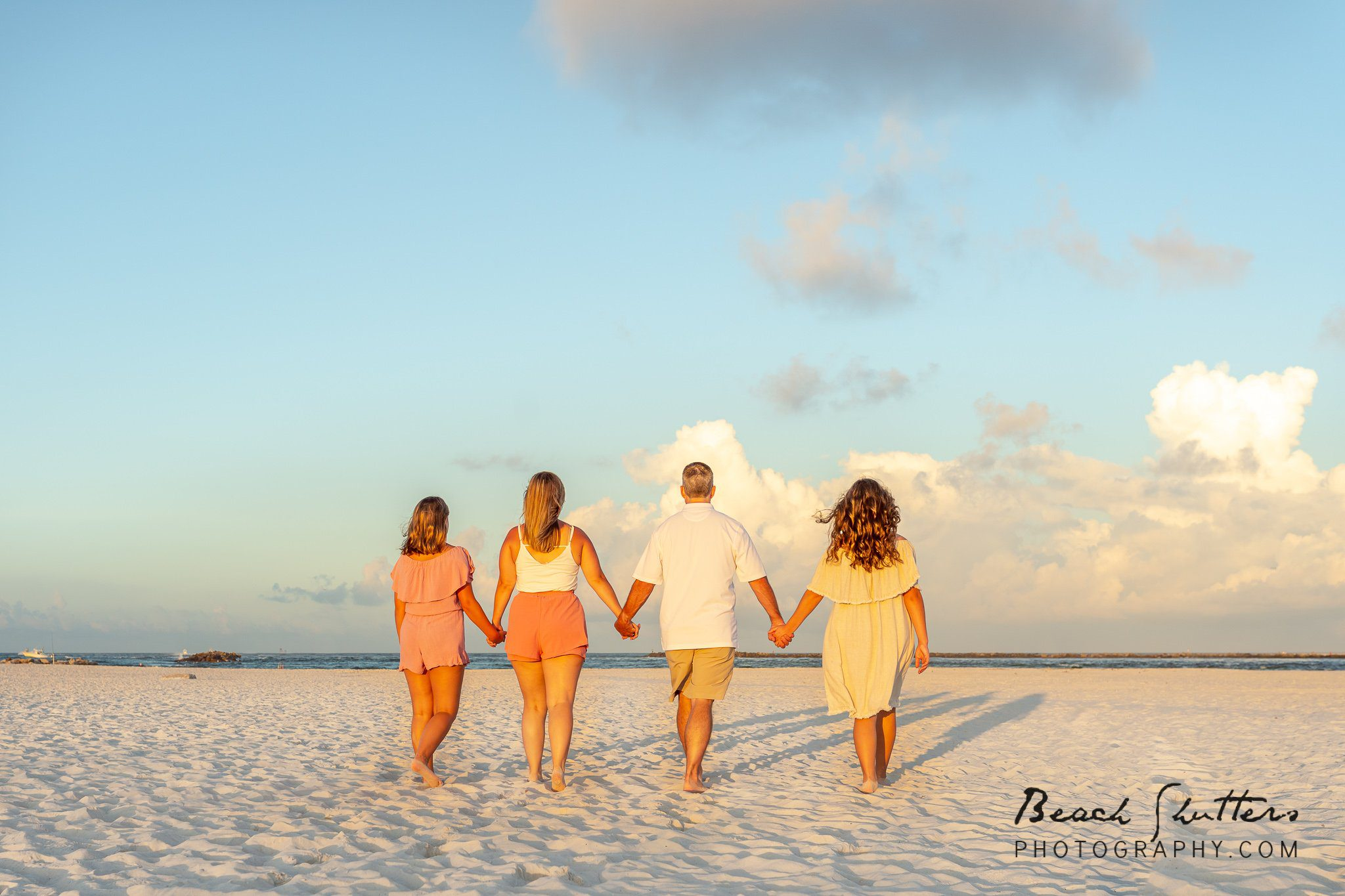 family photography at the rocks in Orange Beach